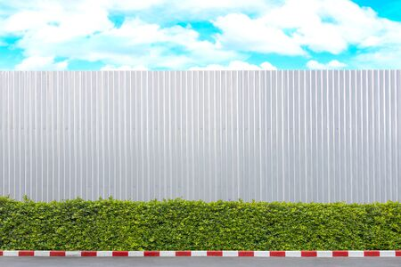 The aluminum wall used in the construction area. And there were trees beside the wall.