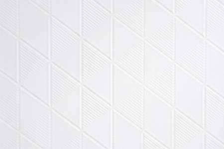 White tiles with pattern wall texture for the decoration of the cafe.
