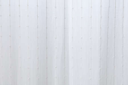 Thin white curtains filter the light. white background for wallpaper.