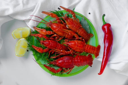 Boiled crayfish and red pepper on white background