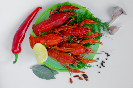 Red pepper crayfish or red pepper on white plate.