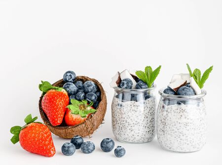 Jars with chia pudding dessert and fresh berries. Healthy eating. Copy space