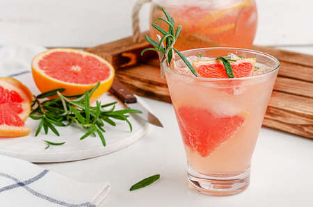 Homemade grapefruit mocktail with rosemary. summer beverage