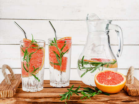 Antioxidant drink with soda, grapefruit and rosemary. Healthy eating and drinking concept.