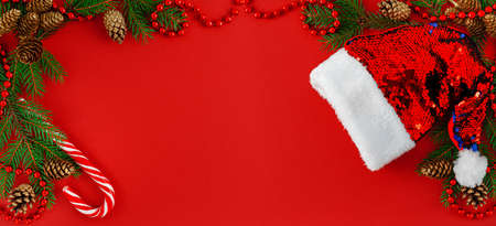 Christmas banner background. Festive composition on red backdrop. Top view.