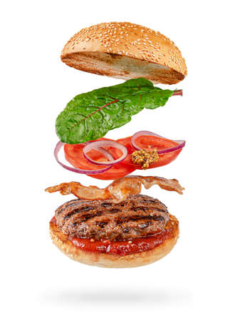 Flying hamburger with clipping path isolated on white background. Fast food