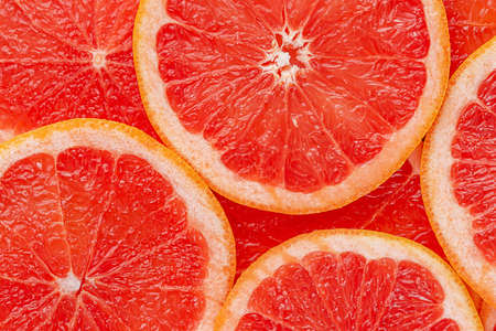 Red grapefruit background. Top view. Stock Photo