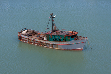 OLD RUSTED FISHING BOAT
