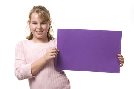 Young blond girl holding sign 版權商用圖片