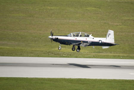 low pass by navy trainer plane