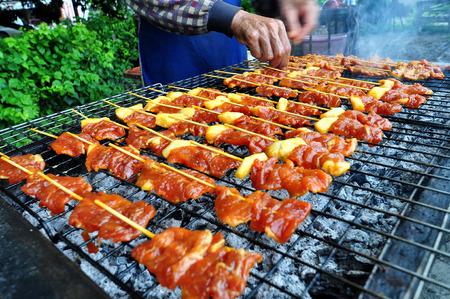 Smoky grilling the marinated pork meat delicious shashlik Stock Photo