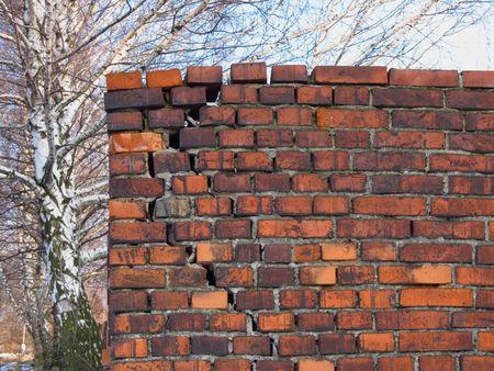 cranny: old broken brick wall Stock Photo