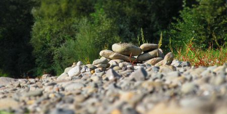 hillock: a hillock of stones with blurred background and foreground