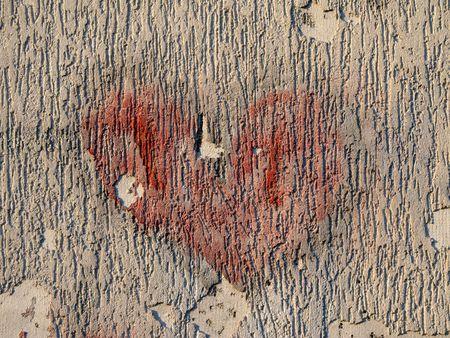 broken wall: dibujo de un coraz�n en la pared rota Foto de archivo