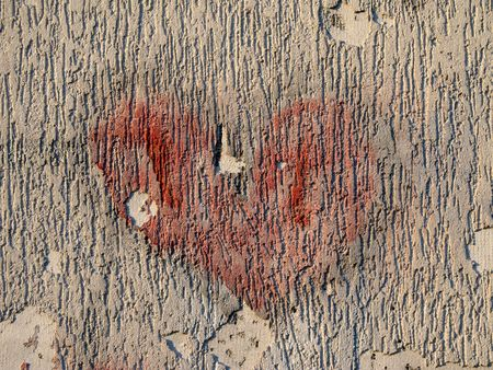 fade away: drawing of a heart on the broken wall