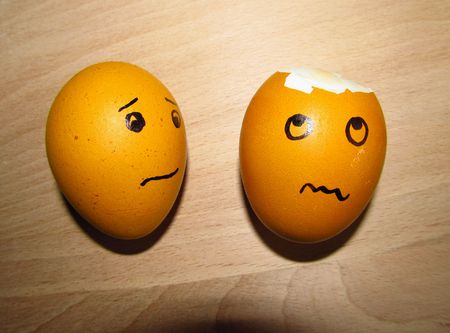 bothered: broken egg and another one with faces