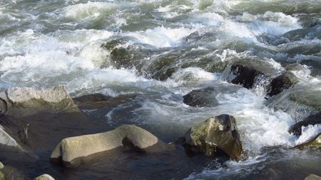 weir: close photo of a weir with rocks on the river Stock Photo