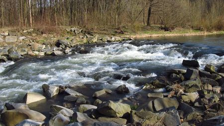 weir: weir with rocks on the river