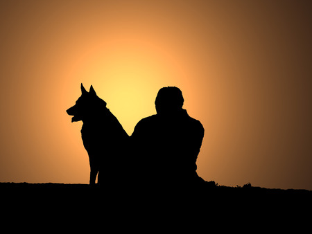 silhouettes of man and dog watching sunset together Zdjęcie Seryjne