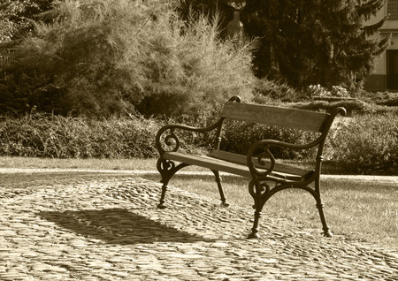 ochre: vintage photo of nice old bench in ochre tones