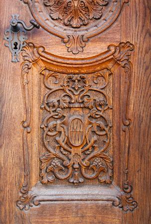 carving: beautiful old carved door made of dark brown wood