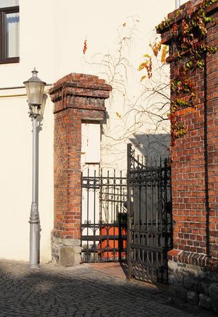 nook: nice nook with old gate, brick walls and lamp in Frydek-Mistek, Czech republic Stock Photo