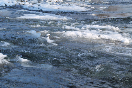coldness: blue river with some ice in winter Stock Photo