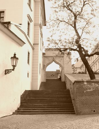 nook: Beautiful nook in Brno, Czech Republic with stairs leading up the old street in ochre tones Stock Photo