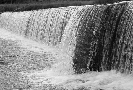 weir: black and white photo of a weir on the river