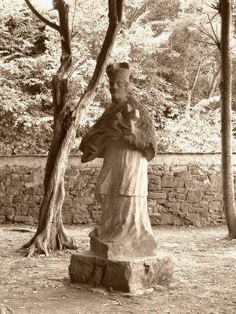 ochre: photo of the old statue in the park in Vizovice, Czech Republic in ochre tones Stock Photo