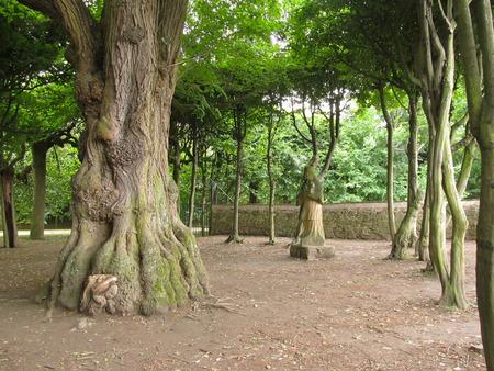 cross recess: old statue in the dark park in Vizovice, Czech Republic
