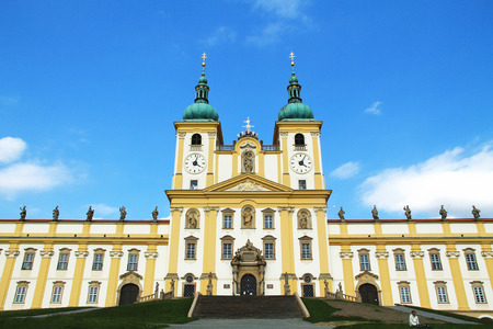 architecture monumental: beautiful white and yellow basilica in Olomouc looming up to the sky, Czech Republic Stock Photo