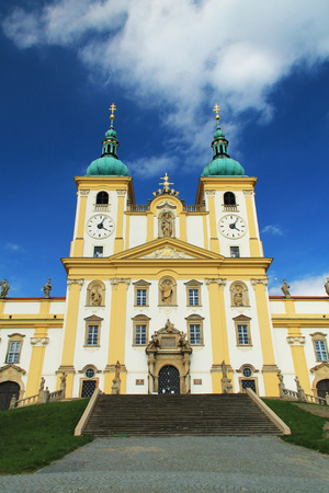 beautiful white and yellow basilica in Olomouc looming up to the sky, Czech Republic Stock Photo