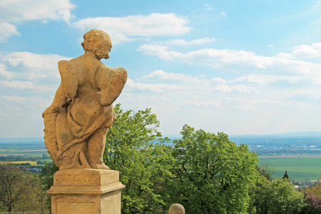 old statue of an angel placed in front of the basilica looking to the landscape, Olomouc, Czech Republic