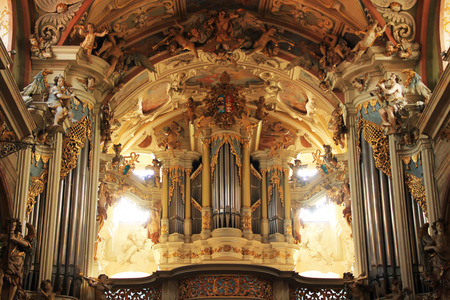 interior of basilica with pipe organ and beautiful baroque statues and paintings in Olomouc, Czech Republic