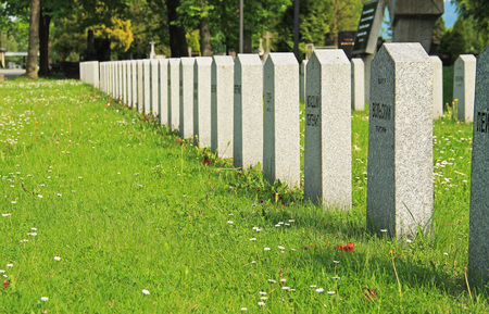 line of tombstones on the cemetery of russian soldiers killed during the world war II in Frydek-Mistek, Czech Republic - editorial