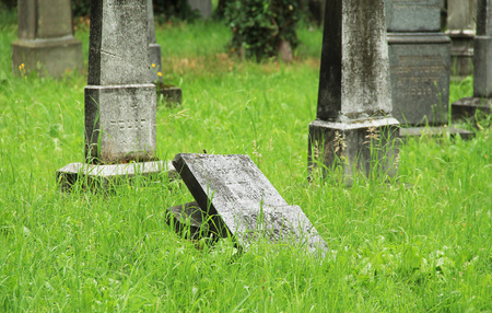 broken old tombstone on the jewish cemetery in Frydek-Mistek, Czech Republic - editorial