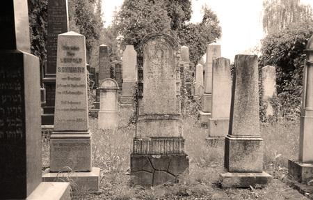 beautiful old tombstones on the jewish cemetery in ochre tones in Frydek-Mistek, Czech Republic - editorial
