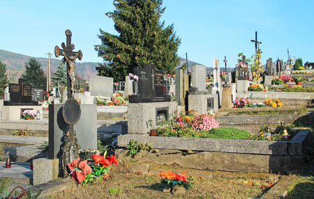 decorated graves on the cemetery in Prazmo, Czech Republic