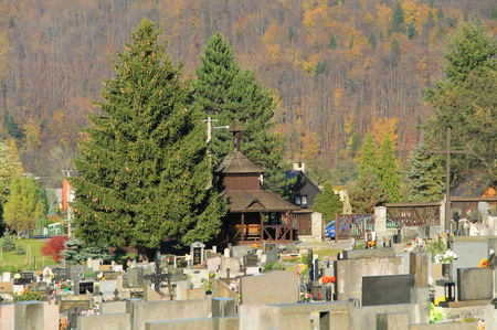 view on the cemetery with old wooden chapel, Prazmo, Czech Republic Editorial