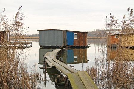 bizzare post-apo looking cottage with narrow catwalk on Hermanicky pond, Czech Republic