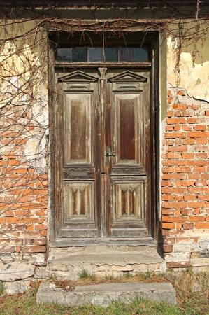 wooden door of an old broken house