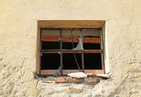 Broken window of an old abandoned house, Vendryne, Czech Republic
