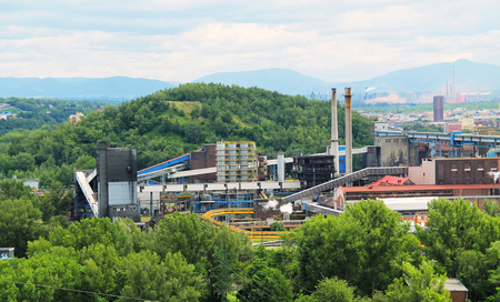 view on the industrial factory and surprisingly green hills in Ostrava, Czech Republic, June 30, 2018 Редакционное
