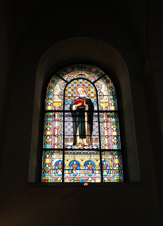beautiful old vitrage window with picture of saint Hedvika in the church of Saint Cyril and Metodej on Radhost hill, Beskydy mountains, Czech Republic