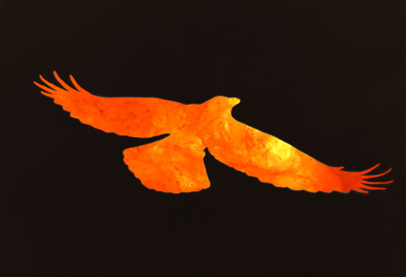 fantasy bird made of fire and lava flying on the black sky Stock Photo