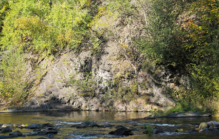 rock at Ostravice river with some trees in autumn, Czech Republic Stok Fotoğraf