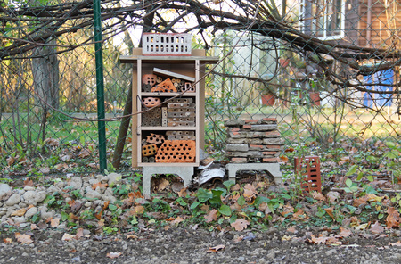 insect hotel for various bugs and invertebrates in the autumn garden