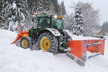 snowplough ploughing snow-drift on Visalaje, Beskydy mountains, Czech Republic, January 24