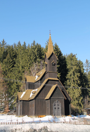 old wooden church in village of Bila, Beskydy, Czech Republic on sunny winter day Stock Photo